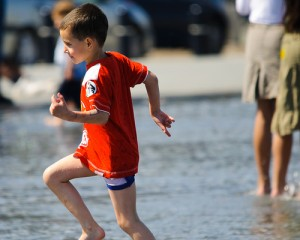 Carmel Valley San Diego Community | Dr. de Freitas | Boy Playing in the Water